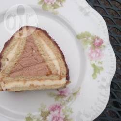 Торт ДомикИнгредиенты  Порций: 8  2 пачки печенья (36 штук) молоко или кофе для размачивания 250 г сливочного масла 300 г творога или творожной массы 1 ст.л. какао Шоколадная помадка (глазурь) 2 ст.л. сахара или сахарной пудры 2 ст.л. какао-порошка 2 ст.л. сметаны