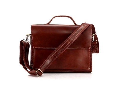 DEPUTY: Classic Red Brown Leather Briefcase  A classic, professional, vintage red brown leather briefcase that will keep your style fresh and minimalist time after time.  This briefcase is the perfect balance of exclusivity and cool. An impressive clean briefcase, it maintains a vintage attitude with signature red brown leather craftsmanship and a great modern design.  Perfect for gadgets like Laptops, iPads, eReaders, etc.  £94