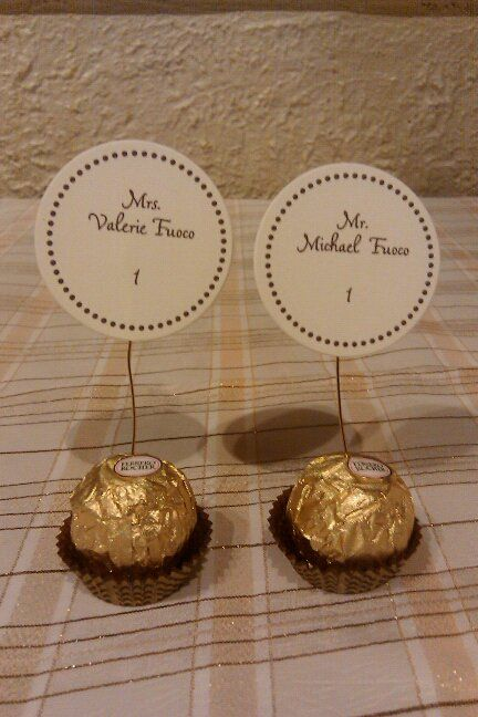This is too cute! Escort Cards on Ferrero Rocher... love those things!