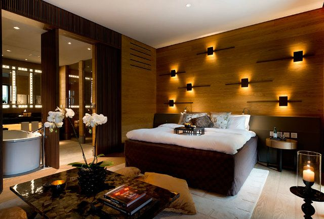 The Chedi Andermatt, Switzerland Designed by Denniston  This room makes me think of 1970's cool.  That king-sized bed could easily be a waterbed!  Thank goodness it isn't but can't you just see it?