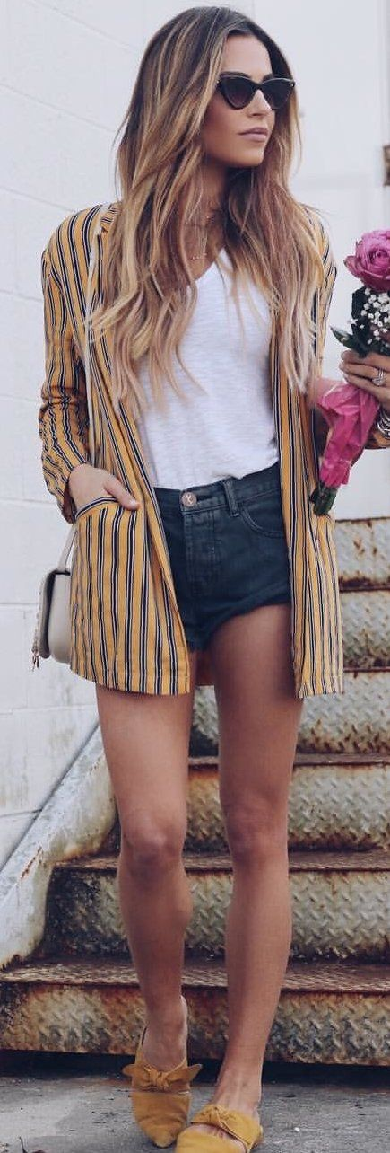 #spring #outfits woman wearing brown and black pinstriped cardigan and blue shorts. Pic by @jordanunderwood