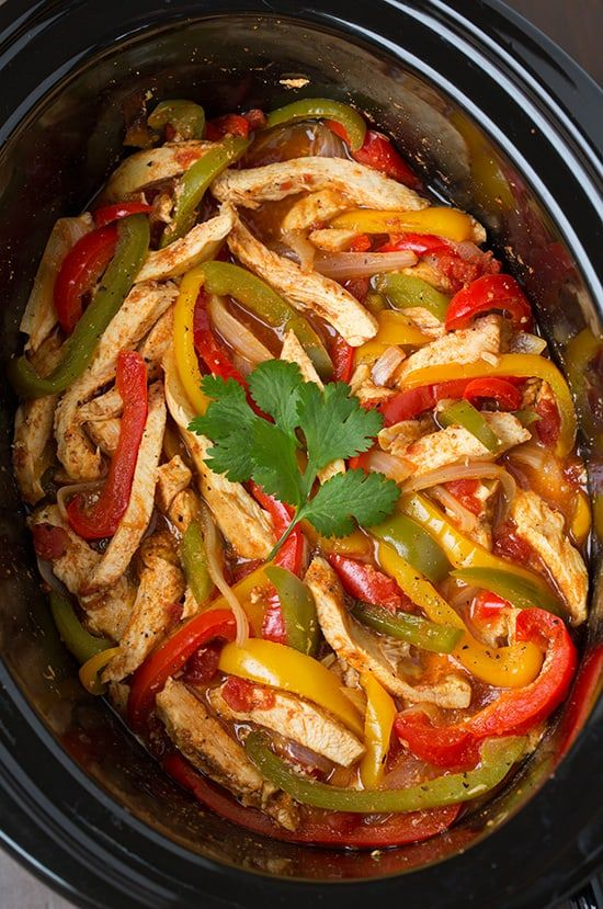 The easiest chicken fajitas recipe! Yet they are still so tender and flavorful! This slow cooker method is perfect for busy weeknights.
