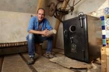 Kevin McCloud with his home made oven, constructed using an old safe