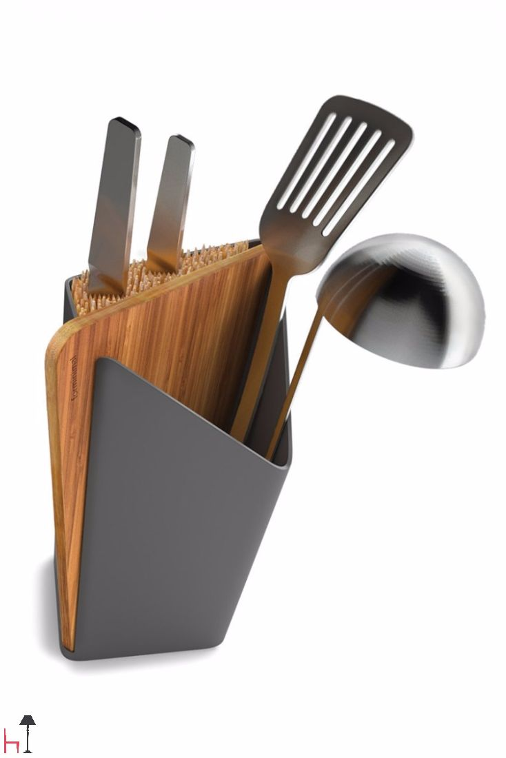 The Forminimal utensiil holder set includes a utensil holder, a knife holder (knives not included) and an integrated bamboo cutting board.