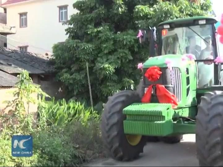 Thinking about something different to your wedding ceremony? This might offer a clue. A man in southwest China has led a motorcade of eight big tractors to take his bride to the wedding ceremony. Click this video to watch this tractor wedding!
