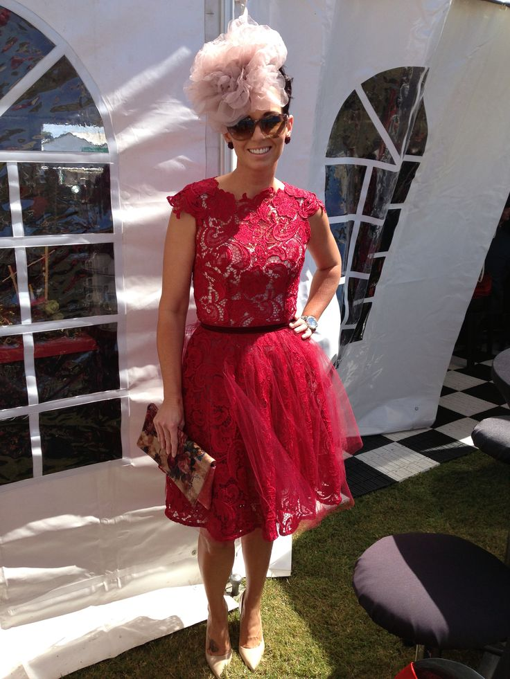 Red lace dress with tulle. Large flower fascinator.