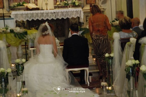 the bride and groom sat at the altar during the ceremony