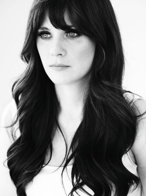 Zooey Deschanel... Thinking about getting the across bangs again:D