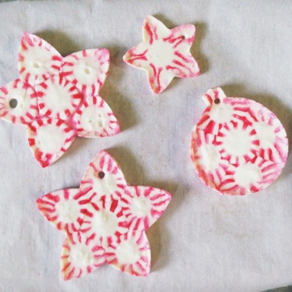 Make Melted Peppermint Candy Christmas Ornaments: on parchment paper, candy inside cookie cutters that have been sprayed with Pam, 350 degrees for 3-9 minutes