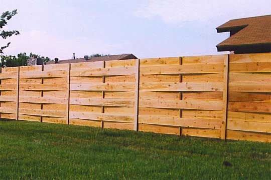 Wide plank woven fence