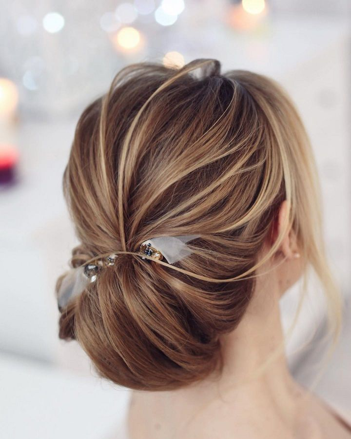 Pretty low chignon hairstyle for long hair | Chignon Wedding Hair. Get inspired with this hand-picked bundle of bridal that are sure to bring out