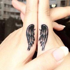 Best friend tattoos, wings.