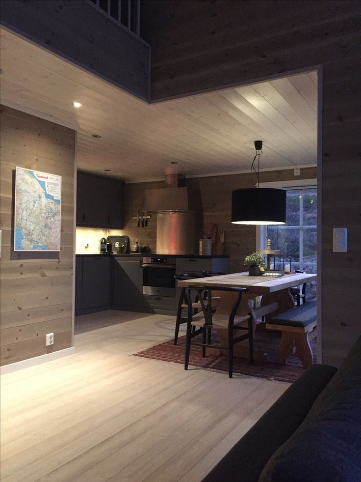 Cabin kitchen, wooden walls and danish desing chairs
