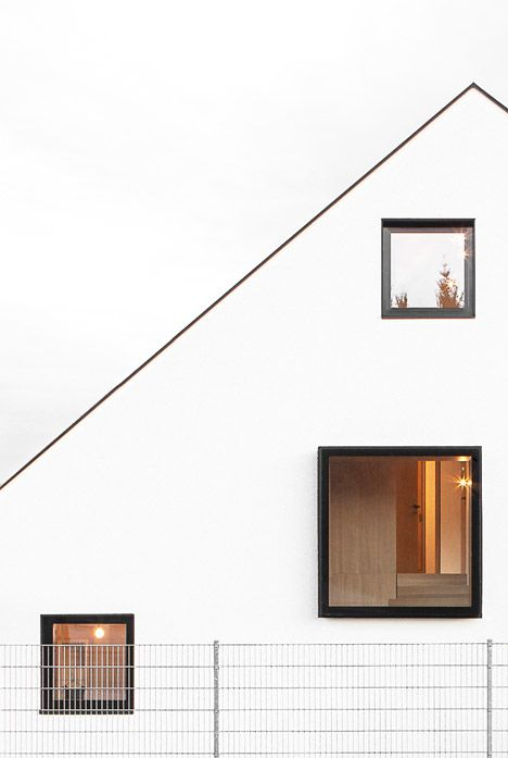 House B by Format Elf contains two floors within its large asymmetric roof.