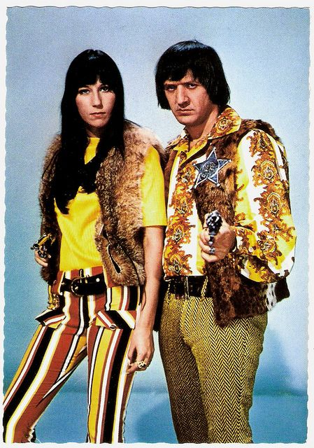 *Sonny & Cher    Vintage postcard by ISV, no. H 129.    Sonny & Cher were an American pop music duo, actors, singers and entertainers made up of husband-and-wife team Sonny and Cher Bono. The couple started their career in the mid-1960's as R backing singers for record producer Phil Spector. They achieved fame with two hit songs in 1965, Baby Don't Go and I Got You Babe. Signing with Atco/Atlantic Records, they released three studio albums in the late 1960's, as well as the soundtrack…