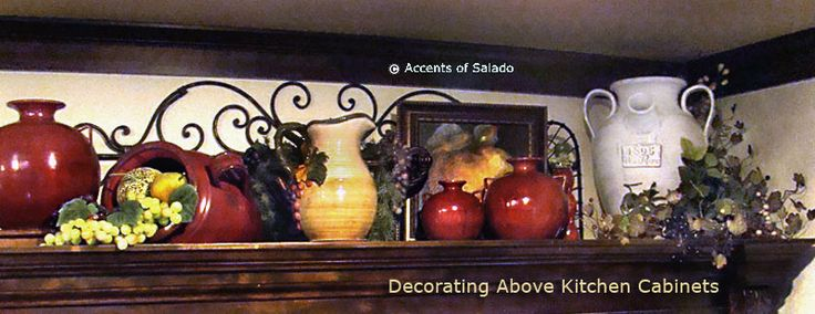 In your Tuscan kitchen, group large urns, pots, bowls and plates, some reclining and some standing, with similar type objects on a an open shelf or above kitchen cabinets. Consider a wrought iron backdrop, small framed artwork, old copper cooking utensils and decorative floral, fruits and greenery in your above cabinet displays.