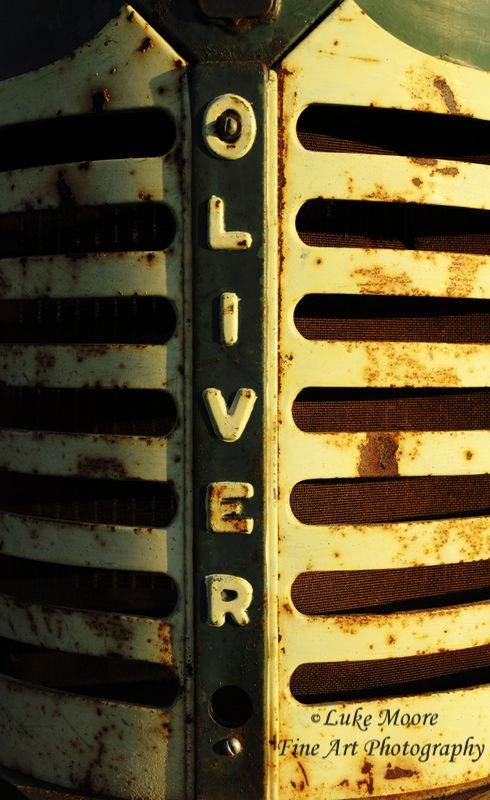 """It's harvest time... the front of an antique Oliver Tractor.  Such a beautiful rusty patina to this tractor.  Farmhouse or agricultural decor perfect gift for that special someone who loves tractors. """"A Tractor Named Oliver"""" by Luke Moore."""