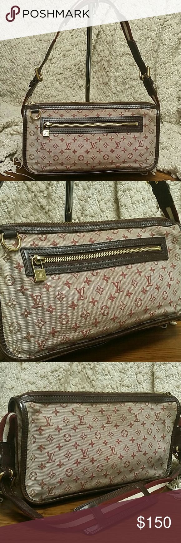 Authentic Louis Vuitton Monogram bag Pochet Catherine.  Good condition. Minor wear to corners.  Strap is great, very clean, and slightly adjustable.  The monogrammed canvas does not have any rips, tears. The inside is pretty clean. Nothing glaring. The canvas is in very good condition and if you cleaned it, it would be spectacular.  Just minor soiling due to use. Haven't used this bag in a long time.  Cannot locate the dustbag.  The color is called 'cherry'. Louis Vuitton Bags Clutches…