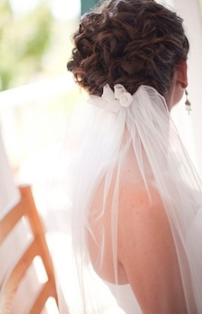 We love this gorgeous, intricate updo.