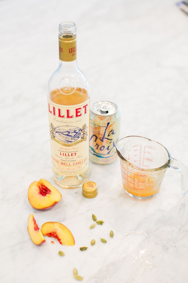 Peach-Apricot Lillet Blanc Fizz |  1 cup coarse sugar 20-30 whole cardamom seeds 3 ounces Lillet blanc 1 ounce peach juice (freshly juiced if possible) or nectar ½ ounce apricot juice (freshly juiced if possible) or nectar 2 to 3 ounce Peach-Pear LaCroix sparkling water OR Seagram's White Peach Seltzer