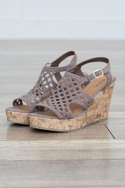 Shop our Crochet Wedge Sandal. Available in taupe and black. Free shipping on all US orders!