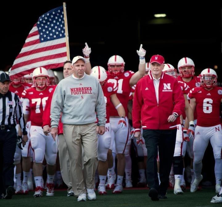 Coach Osborne leading the Huskers out of the tunnel one final time in Memorial Stadium