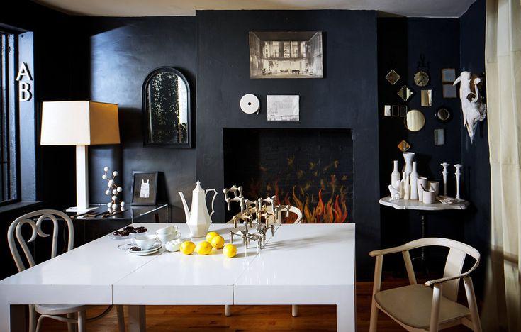 dark walls, white table