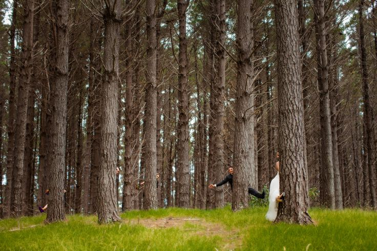 Playing hide and seek in the forest at Whangaihe bay wedding with Susi Liddington Creative. www.susiliddington.com www.jennayoungphotography.co.nz