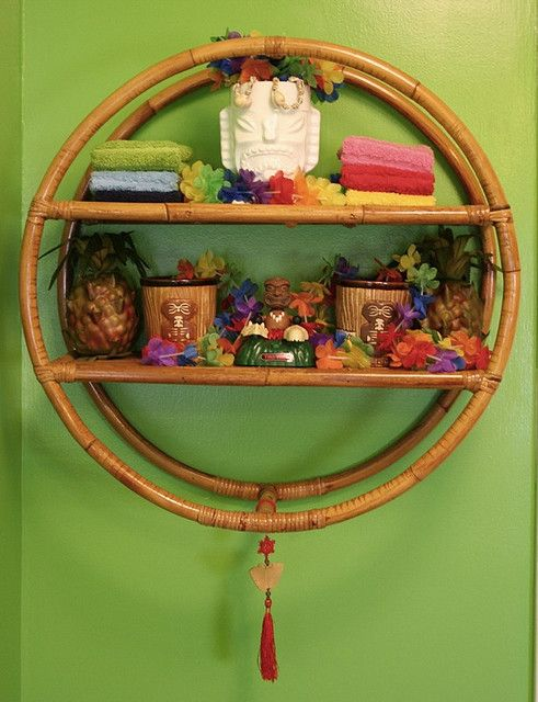 I have this bamboo shelf in my hallway with my tiki mugs on it! It's awesome!!