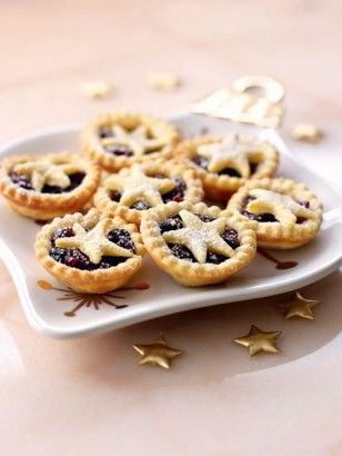 Nigella's star topped mince pies.  Recipe sounds lovely but I tend to buy it in a jar from the supermarket!  I also top mine with lemon sponge instead of the star as it offsets the often overly sweet mincemeat.  Just bake the same way and dust with icing sugar when cool.