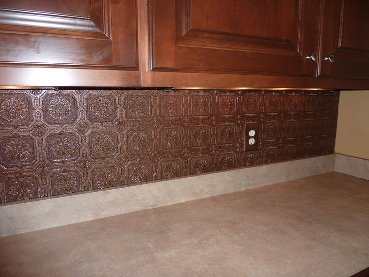 Textured Wallpaper Backsplash Painted With Aged Copper