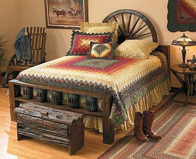 Love the trunk, the wagon wheel headboard, and that quilt is stunning.
