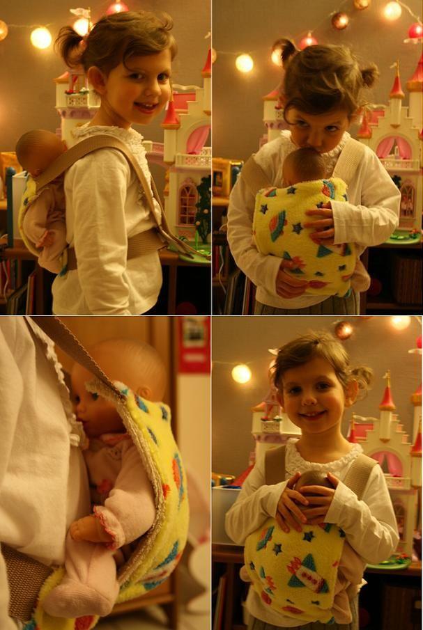 """Il y a un petit bout de temps, j'avais proposé à Anna qui réfléchit régulièrement à des accessoires utiles pour sa poupée (les idées ne manquent pas ;), de lui faire un porte bébé, un """"porte poupée"""" en fait. Avec le """"tissu fusée"""" choisi par notre demoiselle..."""