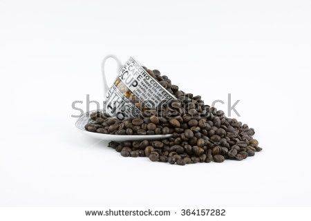 Coffee beans pouring out of a mug
