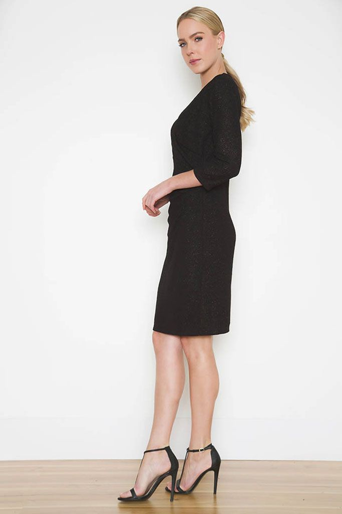 Noni B   Elia Dress   The Elia Dress is a wardrobe staple for any special occaision. The mock wrap cut is flattering and timeless, and the added metallic detailing in the fabric gives an extra glitz to the standard black. Keep accessories to a minumum to make sure the dress does the talking.  3/4 length sleeve Mock wrap design Metallic fabric V neck Polyester/Elastane with Polyester lining