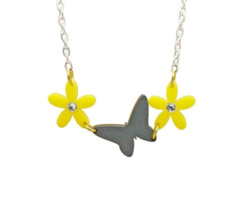 Fun Floral Daisy and Butterfly Charm Necklace Made with Swarovski elements and Perspex using a silvery Sparkle and Beautiful bright yellow Comes on a Silver plated or Sterling silver Chain Chain length Approximately 16-18 inches Each charm size: (Approximately) 1 inch by 1 inch
