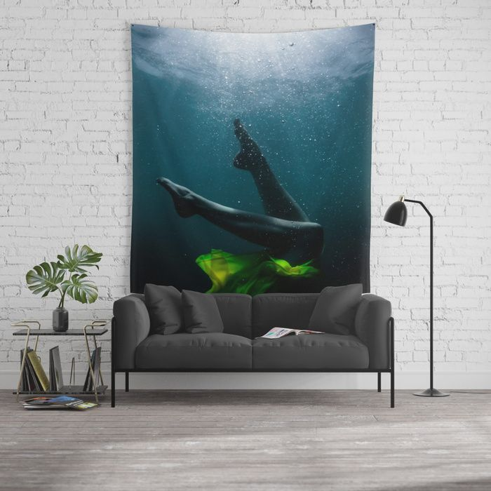 Underwater picture depicting the legs of a woman in a yellow dress dancing, with her feet reaching for the surface. #underwater #photography #legs #feet #woman #girl #bubbles #ophelia #yellow #dress #sea #water #ocean #walltapestry #tapestry #homedecor #interior #design