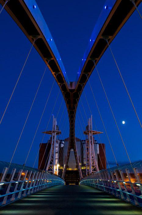 The Salford Quays Millenium Footbridge at night. Greater Manchester