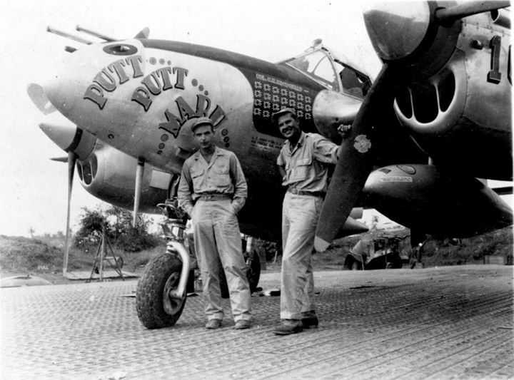 """USAAF pilots Colonel MacDonald and Al Nelson in the Pacific Ocean with MacDonald's P-38J Lightning aircraft """"Putt Putt Maru"""" 1944."""