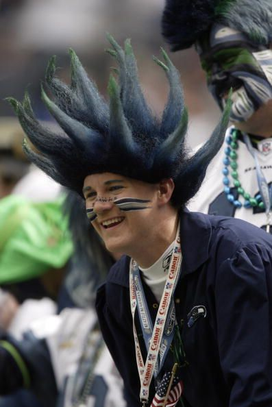 Seattle Seahawks fan roots for his team during the game against the New Orleans Saints at Seahawks Stadium on September 7 2003 in Seattle Washington...