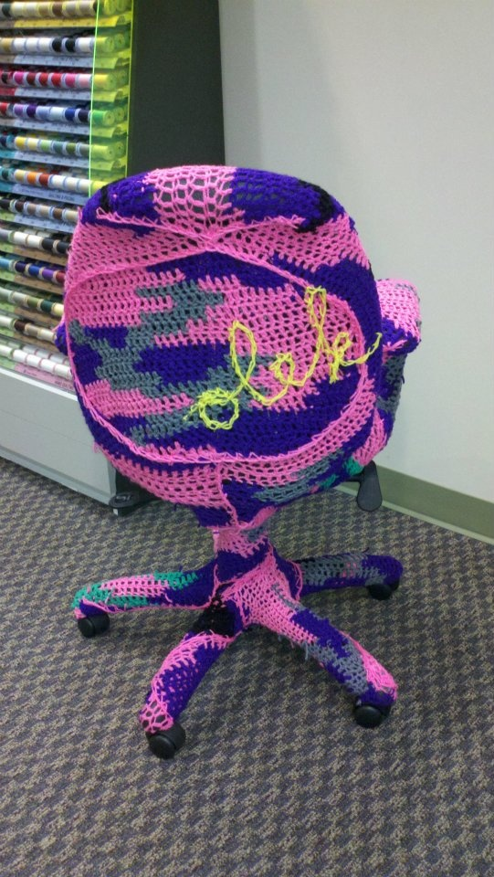 Olek yarn bombs the Coats & Clark office in Charlotte with Red Heart Super Saver yarn.