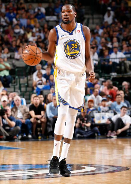 Kevin Durant of the Golden State Warriors handles the ball against the Dallas Mavericks on October 23 2017 at the American Airlines Center in Dallas...
