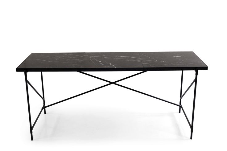 The Desk - Black on Black - Black Marble  This edition consists of a honed black marble top that has been quarried into 3 larger fragments and mounted onto a slender, black frame. Marble is a natural product with unique patterns and expressions - that also makes every single table unique.