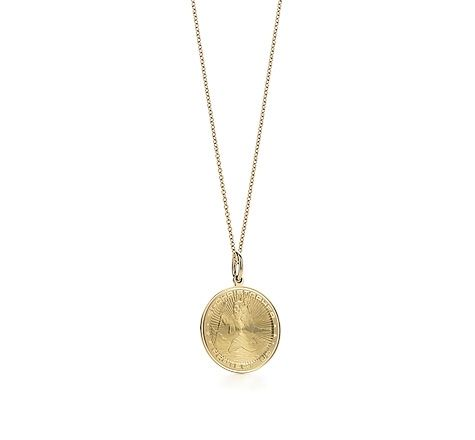 Tiffany & Co.   Item   Saint Christopher charm in 18k gold on a chain.   United States