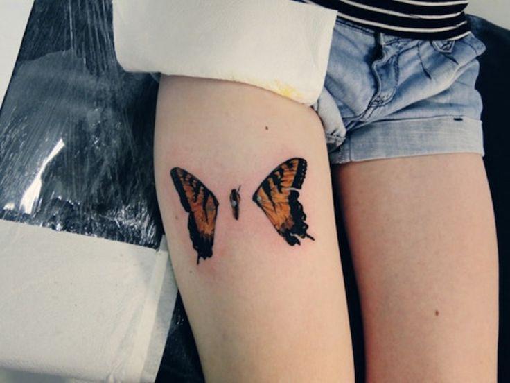 tatouage-papillon-femme-jambe