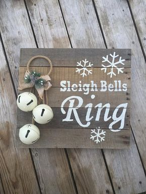 This one of a kind, hand painted pallet sign will be a cute addition to your Christmas decor. White bells are mounted to this pallet sign to complete the package and add a little jingle to your holiday season. The sign measures