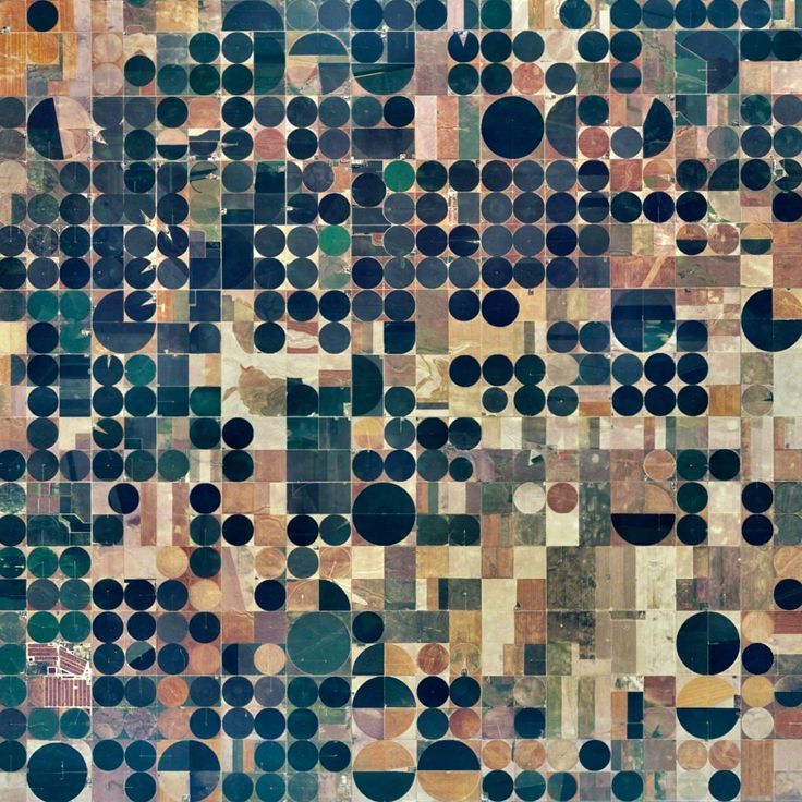 3/29/2016 Pivot Irrigation Fields Copeland, Kansas, USA 37.631919632°, -100.706841568°  Pivot irrigation fields cover the landscape north of Copeland, Kansas, USA. Powered by electric motors, lines of sprinklers rotate 360 degrees to evenly irrigate crops.