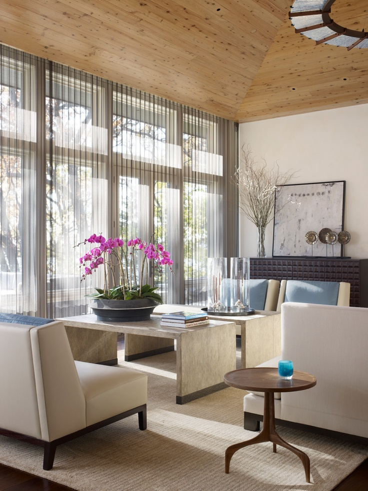 Contemporary lake house project by tom stringer design partners featuring cascade coil drapery