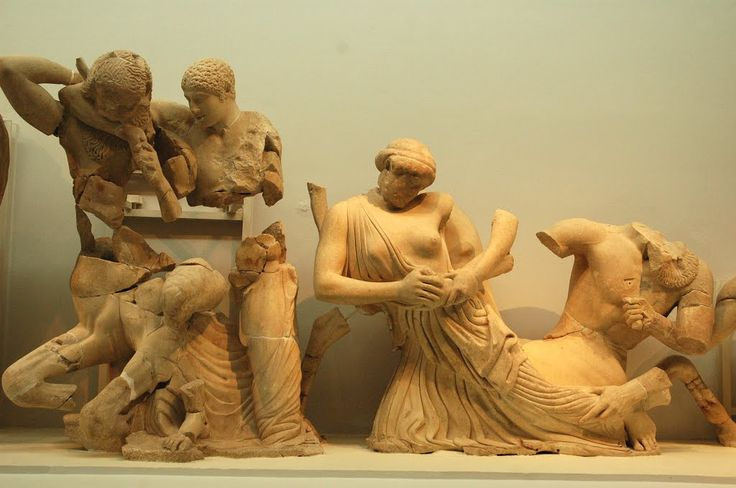 The west pediment of the Temple of Zeus: Battle of Lapiths and Centaurs, Olympia Archaeological Museum, Greece