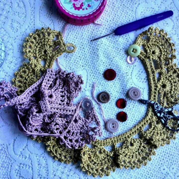 Sewing buttons on my crochet collars